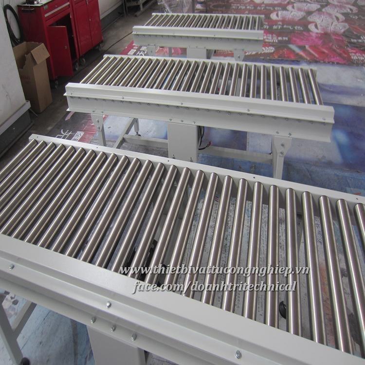 Băng Tải Con Lăn Khung INOX 304 Thiết Kế Lắp Đặt Theo Yêu Cầu - Băng tải Doanh Trí